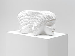 deatil of Sarah Peters' scultpure - two neo classical heads looking away from each other