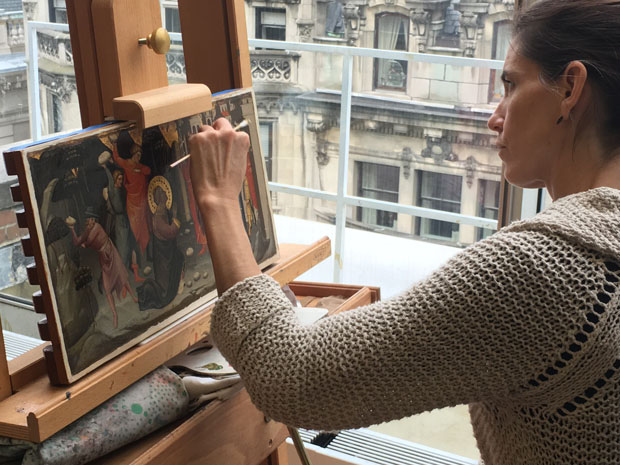 Student restoring a painting by Lorenzo di Niccolo